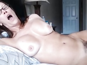 Milf doll laying on sofa unsheathing her enormously unshaved pussy fuck-hole