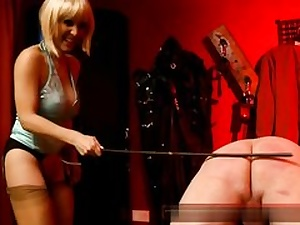 Insatiable blond dressed in a peruke pawing his ass and then smacking it rock hard