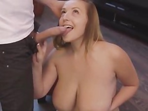 Mischievous cougar with gigantic boobies posing nude in front of the camera