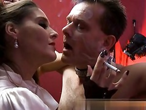 Mature bitch is dominating over this horny fellow while smoking a cig