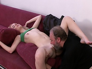 After blowing a youthful cock, the senior doll rails his wood